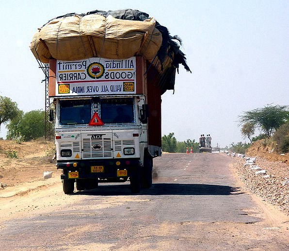 India Traffic Loaded Transportation Truck Car Over